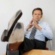 Stock Photo: Business Man With Feet On The Table