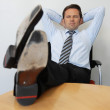 Stock Photo: Business MWith Feet On Table