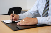 Close-Up Of Writing Hands In Business Environment — Stock Photo