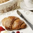 Breakfast arrangement with croissant — Stock Photo