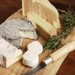 Stock Photo: Variety Of Cheese On Wooden Platter