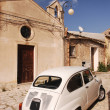 Stock Photo: Ckassic Fiat 500 In Front Of Church