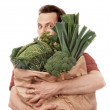 Foto Stock: Mholding bag full of vegetables