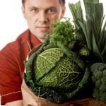 Man holding bag full of vegetables — Stock Photo #25982467