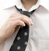 Business man getting ready for work, fixing his tie — Stock Photo