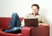 Man doing some laptop worh at home — Stock Photo