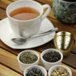 Tea with loose tea in little bowls — Stock Photo
