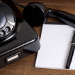 Old Black Telephone and Notepad — Stock Photo