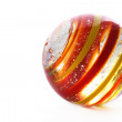 Striped glass marble on white — Stock fotografie