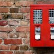Red Gumbal, Chewing Gum Machine hanging on An Old Wall — Stock Photo