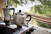 Tea and coffee pot on campside — Stockfoto