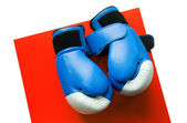 Boxing gloves on a red table — Foto Stock