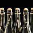Stock Photo: Hand corked and tied champagne bottles
