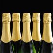 Stock Photo: Bottle necks of Champagne bottles on black background