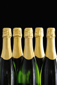 Bottle necks of Champagne bottles on black background — Stock Photo