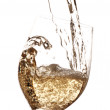 图库照片: White wine being poured into glass