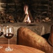 Stock Photo: Two Glasses Of Red Wine At A Cosy Fireplace