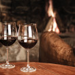 Two Glasses Of Red Wine At A Cosy Fireplace — 图库照片