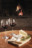 Two Glasses Of Red Wine At A Cosy Fireplace — Foto Stock