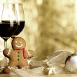 Two glasses of Red Wine, Gingerbread Man and Christmas Ornaments — Stock Photo #27980165