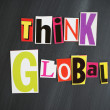 """THINK GLOBAL"" letters on Chalkboard — Foto Stock"