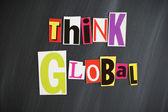 """THINK GLOBAL"" letters on Chalkboard — Stock Photo"