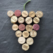 Wine: Corks in grape shape on slate — Stock Photo