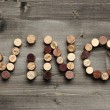 """VINO"" written with corks — Stock Photo"