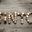 "Stock Photo: ""TINTO"" written with corks"