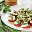 Fresh caprese salad with delicious tomatos, mozzarella and basil — Stock Photo