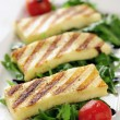 Grilled Halloumi cheese on rocket salad — Stock Photo #29900771
