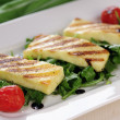 图库照片: Grilled Halloumi cheese on rocket salad