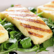 Grilled Halloumi cheese on rocket salad — 图库照片