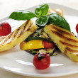 Grilled Halloumi cheese on grilled vegetables with basil — Zdjęcie stockowe