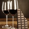 Stock Photo: Red wine and chocolate bar