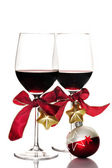 Red wine and Christmas ornaments — Stock Photo