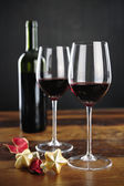 Red wine, bottle and christmas stars — Stockfoto