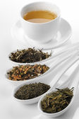 Different sorts of green tea and cup — Stockfoto