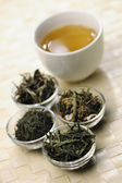 Different sorts of green tea and cup — Stok fotoğraf