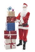 圣诞老人与堆积圣诞节介绍 — 图库照片