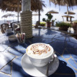 Food: Cappuccino at the beach — Stock Photo