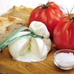 Burrata (sort of very fresh mozzarella cheese), tomato and bread — Stock Photo