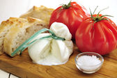 Burrata (sort of very fresh mozzarella cheese), tomato and bread — Stock Photo