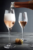 Rose Champagne being filled into Glass — Stock Photo