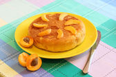 Apricot cake decorated apricots and knife — Stock Photo