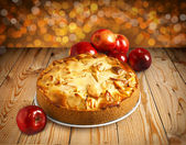 Apple pie on a wooden table — Stock Photo