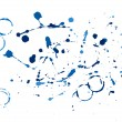 Stock Photo: Blue paint splatters on white background
