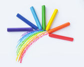 Rainbow and colorful crayons — Stock Photo