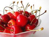 Tasty cherries in glass bowl — Stock Photo