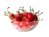 Isolated cherries in glass bowl — Stock Photo
